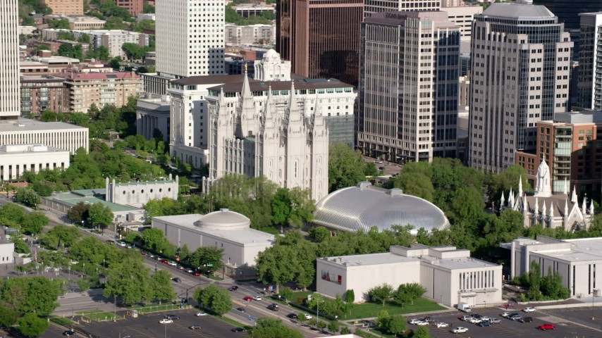Flying by Salt Lake Temple, Mormon Tabernacle, Downtown Salt Lake City, Utah Aerial Stock Footage | AX129_044