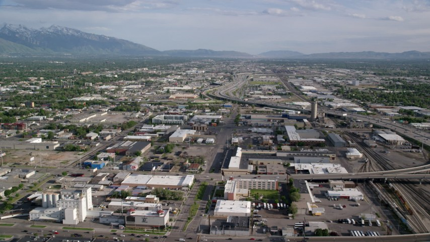 6K stock footage aerial video of flying over streets, buildings, approaching I-15, Salt Lake City, Utah Aerial Stock Footage | AX129_046