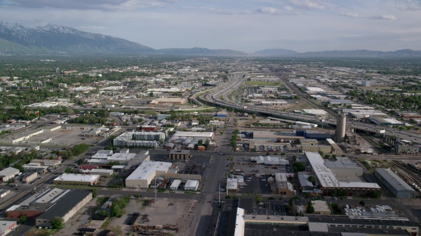 6K stock footage aerial video of flying over streets and buildings, approach Interstate 15, Salt Lake City, Utah Aerial Stock Footage | AX129_047