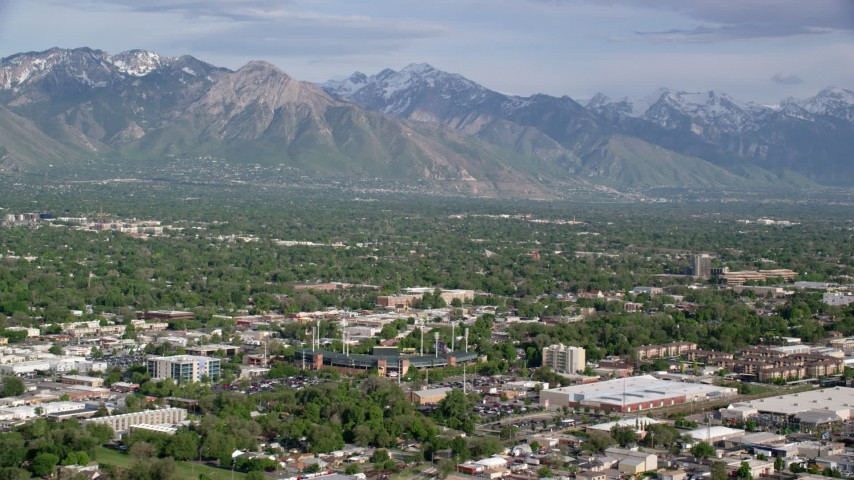 6K stock footage aerial video flyby Wasatch Range, suburbs, seen from Spring Mobile Ballpark, Salt Lake City, Utah Aerial Stock Footage | AX129_048