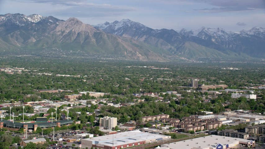 6K stock footage aerial video of flying by suburbs, view of Wasatch Range, Salt Lake City, Utah Aerial Stock Footage | AX129_049