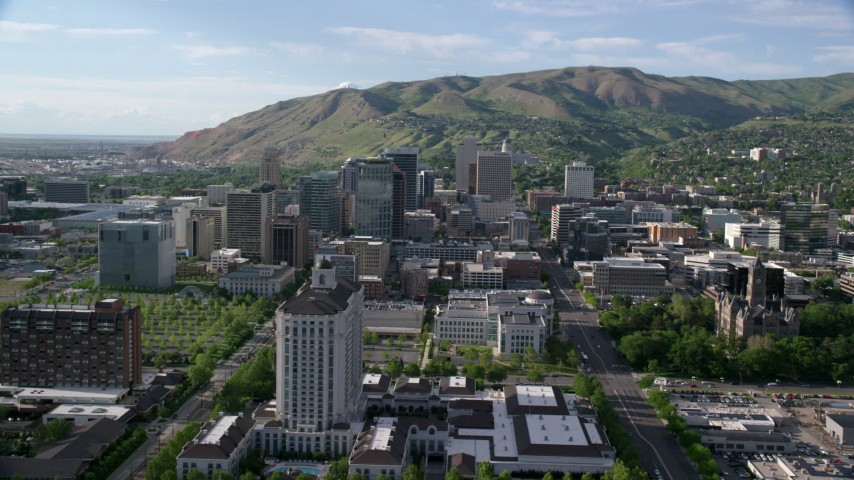 6K stock footage aerial video of approaching Grand America Hotel, city buildings, Downtown Salt Lake City, Utah Aerial Stock Footage | AX129_051