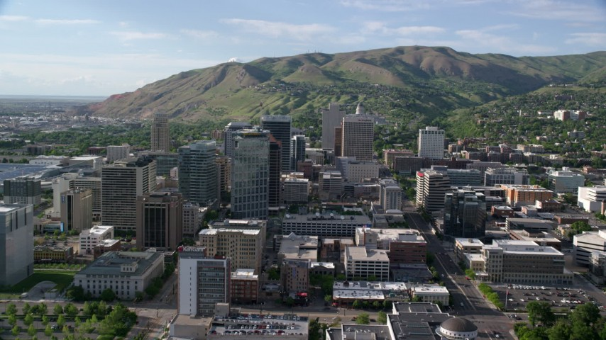 6K stock footage aerial video of approaching buildings in Downtown Salt Lake City, Utah Aerial Stock Footage | AX129_052