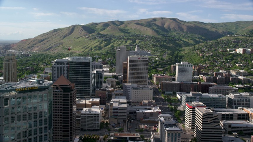 Fly over buildings, approach Utah State Capitol, Downtown Salt Lake City, Utah Aerial Stock Footage | AX129_053