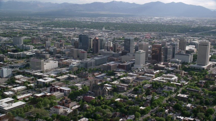 6K stock footage aerial video flyby city buildings, with view of Oquirrh Mountains, Downtown Salt Lake City, Utah Aerial Stock Footage | AX129_061