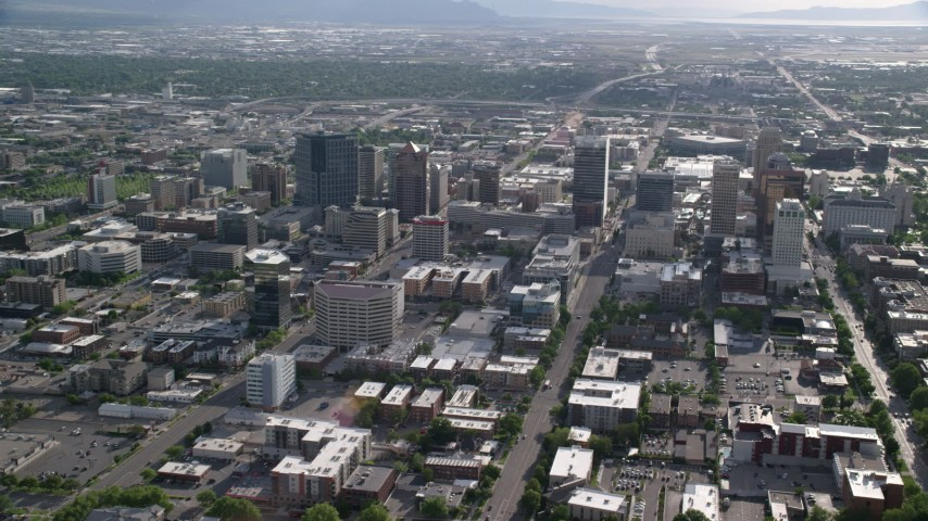 6K stock footage aerial video of flying by city streets and buildings, Downtown Salt Lake City, Utah Aerial Stock Footage   AX129_062