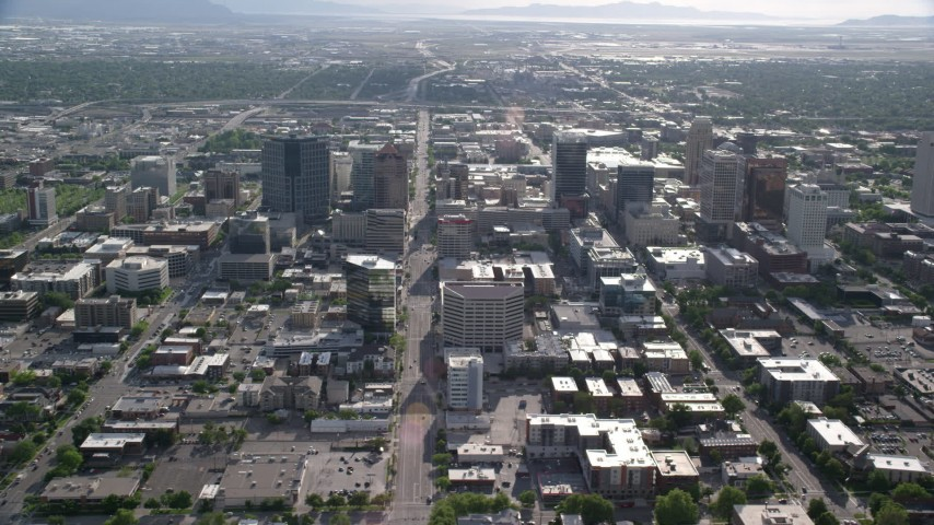 6K stock footage aerial video of passing by city streets and buildings, Downtown Salt Lake City, Utah Aerial Stock Footage | AX129_063
