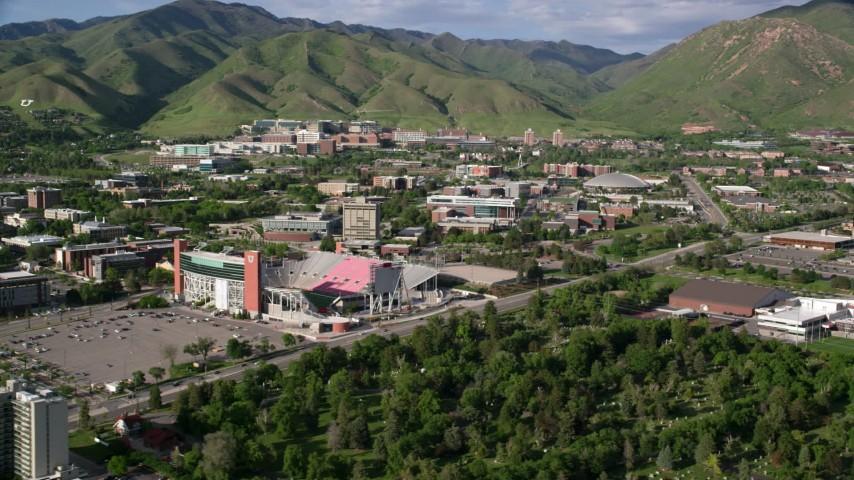 6K stock footage aerial video of passing by the University of Utah, Rice-Eccles Stadium, Salt Lake City, Utah Aerial Stock Footage | AX129_065