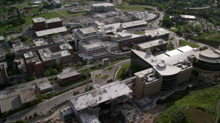 6K stock footage aerial video of passing the University of Utah Hospital buildings, Salt Lake City, Utah Aerial Stock Footage | AX129_074
