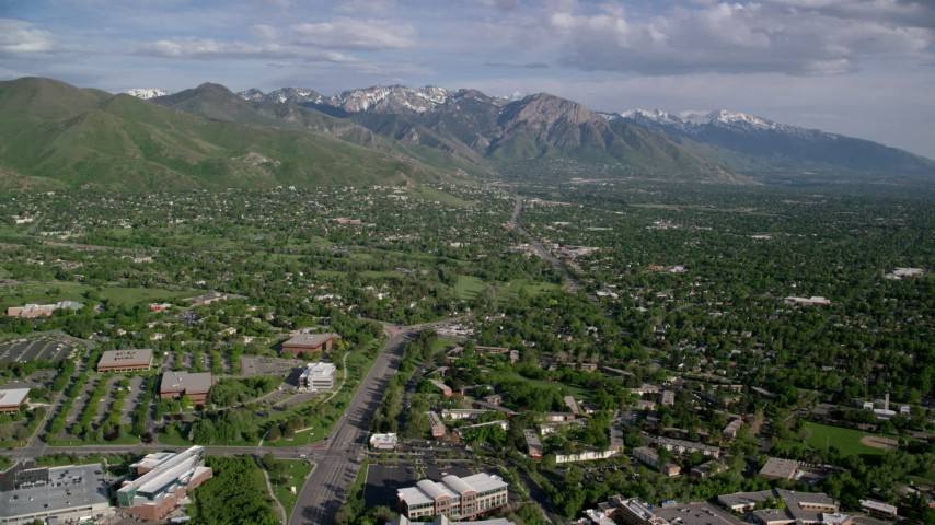 6K stock footage aerial video of approaching Salt Lake City suburbs, Wasatch Range, Salt Lake City, Utah Aerial Stock Footage | AX129_079