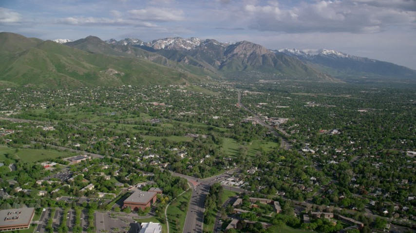 6K stock footage aerial video of flying over suburbs, approaching Wasatch Range, Salt Lake City, Utah Aerial Stock Footage | AX129_080