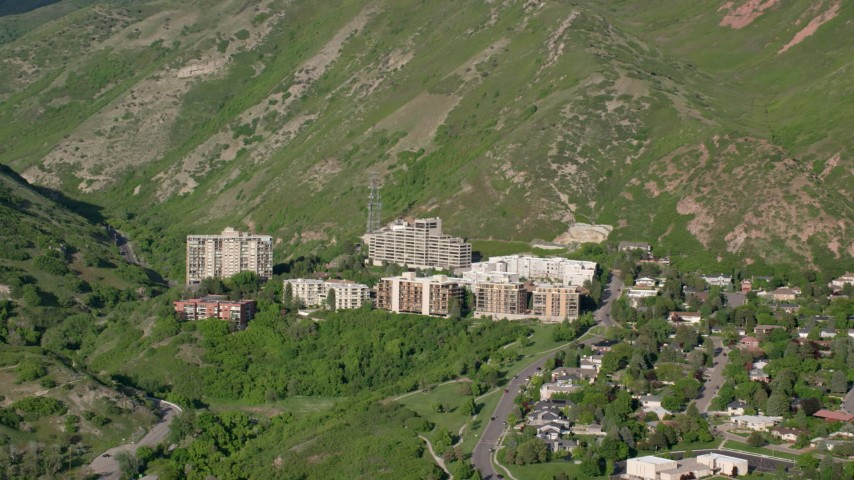 6K stock footage aerial video of flying by apartment buildings, Wasatch Range foothills, Salt Lake City, Utah Aerial Stock Footage | AX129_082