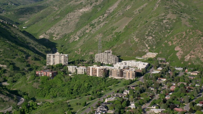 6K aerial stock footage video of passing by apartment buildings, Wasatch Range foothills, Salt Lake City, Utah Aerial Stock Footage | AX129_083