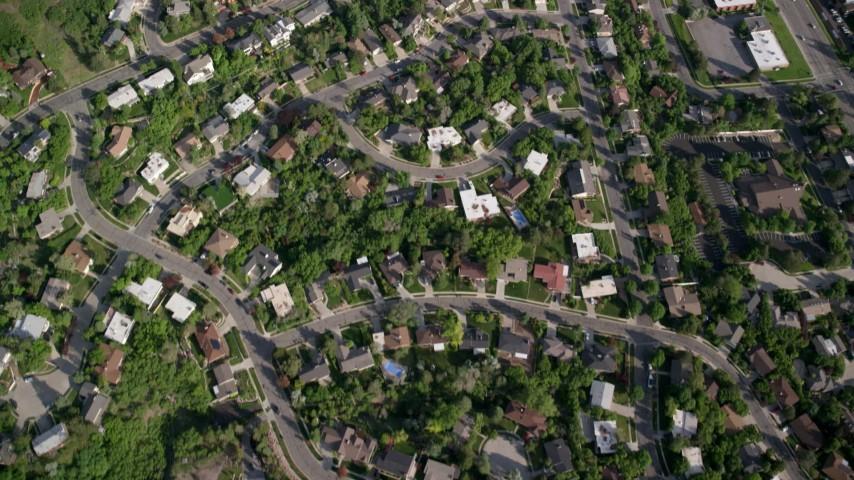 Bird's eye view flying over suburban neighborhoods, foothills, Salt Lake City, Utah Aerial Stock Footage   AX129_086
