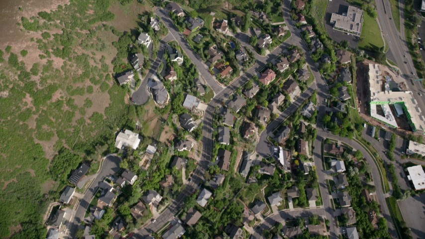 Bird's eye view flying over suburban neighborhoods, foothills, Salt Lake City, Utah Aerial Stock Footage | AX129_087