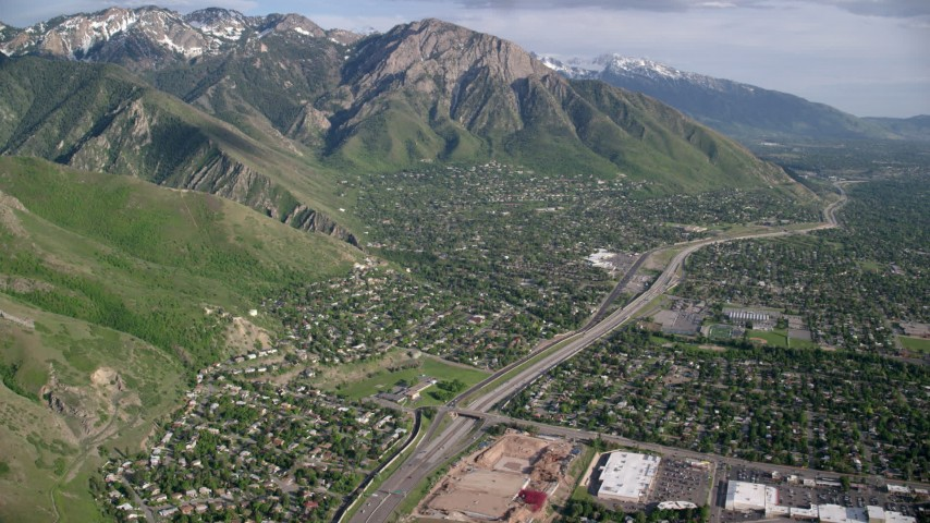 6K stock footage aerial video fly over suburban neighborhoods, approach Wasatch Range, Salt Lake City, Utah Aerial Stock Footage | AX129_088