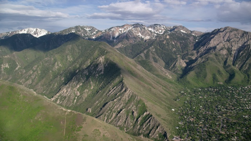 6K stock footage aerial video of flying by the Wasatch Range, Utah Aerial Stock Footage | AX129_090