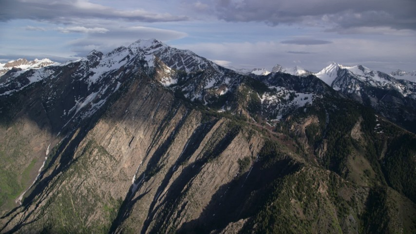 6K stock footage aerial video of an approach to the snow-capped peaks of the Wasatch Range, Utah Aerial Stock Footage | AX129_101