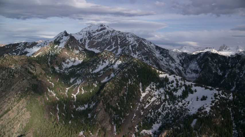 6K stock footage aerial video of passing by snow-capped peaks of Wasatch Range, Utah Aerial Stock Footage | AX129_104