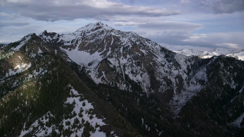 6K stock footage aerial video of snow-capped peaks of Wasatch Range, Utah Aerial Stock Footage   AX129_105