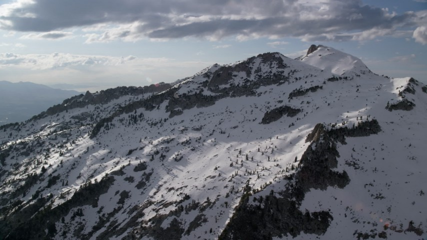 Flying by Lone Peak, snowy Wasatch Range, Lone Peak, Utah Aerial Stock Footage | AX129_121
