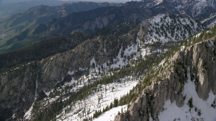 Pan right by Lone Peak, snowy Wasatch Range, Lone Peak, Utah Aerial Stock Footage | AX129_124
