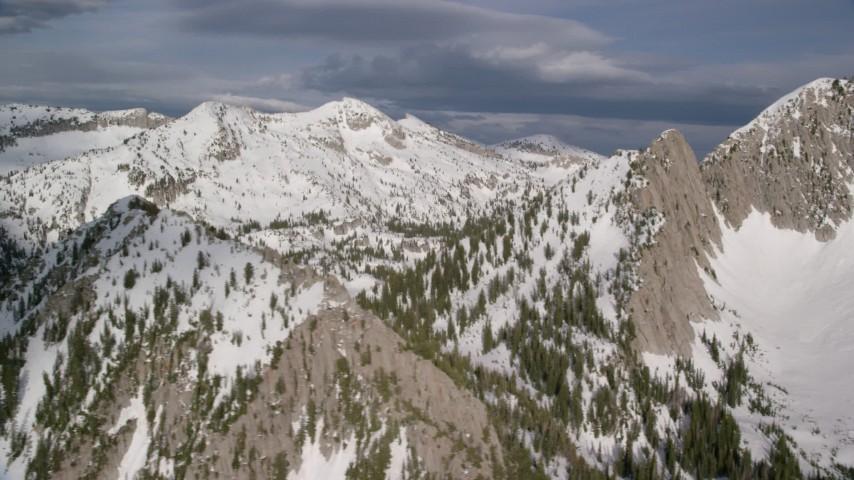6K stock footage aerial video of snow on mountain peaks, ridges, Wasatch Range, Utah Aerial Stock Footage | AX129_126