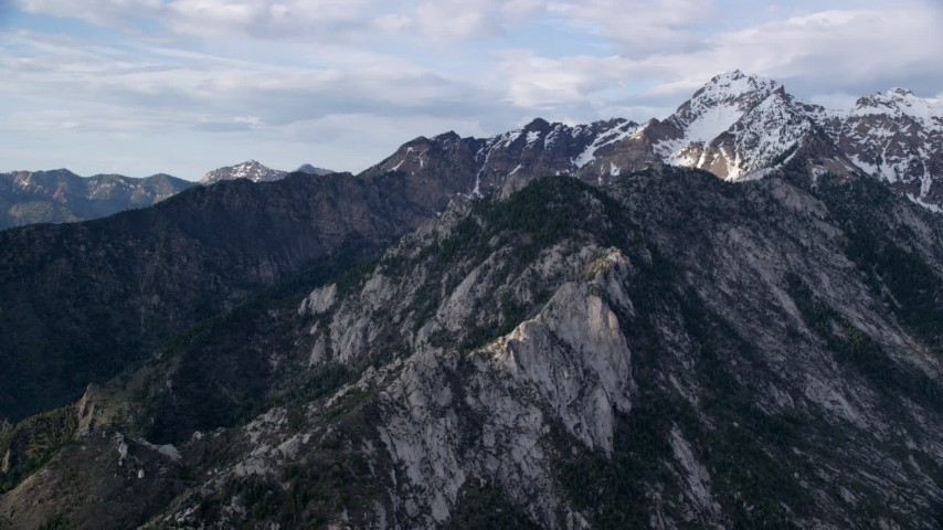 6K stock footage aerial video of flying by mountain peak with light snow, Wasatch Range, Utah Aerial Stock Footage | AX129_129