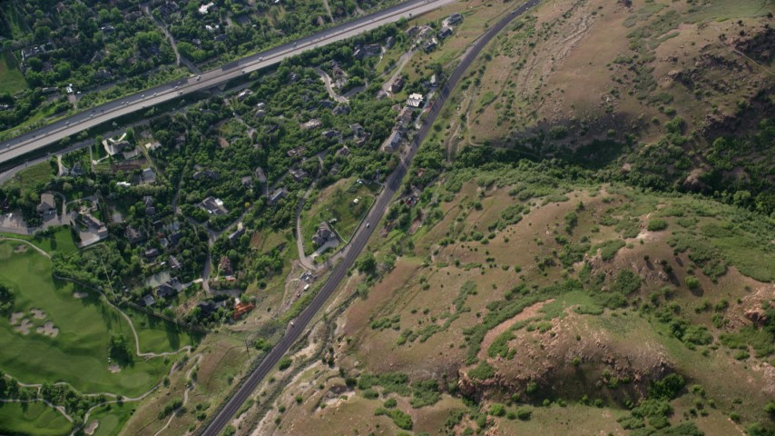 6K stock footage aerial video bird's eye view over suburbs, near golf course, I-215, Salt Lake City, Utah Aerial Stock Footage | AX129_138