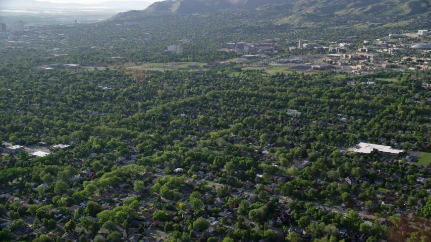 Flying over suburbs near University of Utah, Salt Lake City, Utah  Aerial Stock Footage | AX129_140