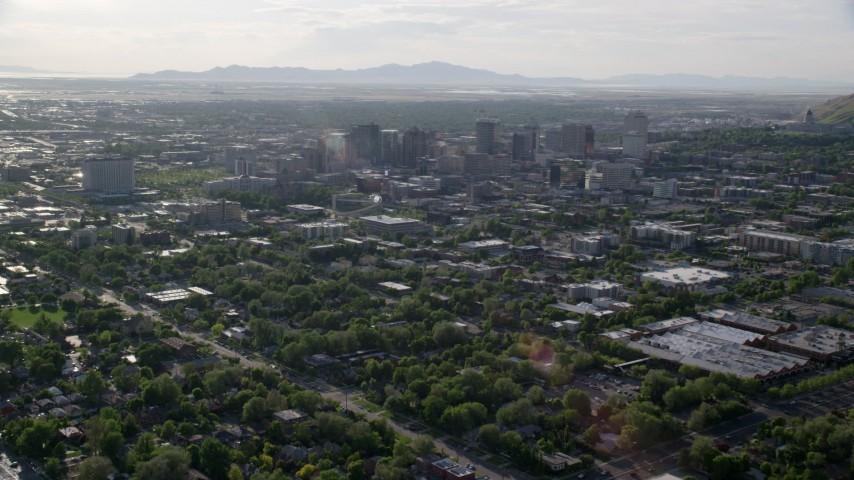 Fly over neighborhoods, approach buildings, Downtown Salt Lake City, Utah Aerial Stock Footage | AX129_143