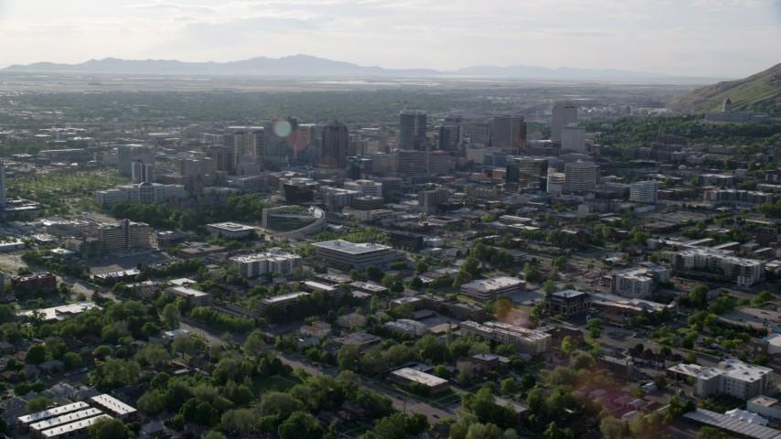 6K stock footage aerial video of approaching buildings in Downtown Salt Lake City, Utah Aerial Stock Footage | AX129_144