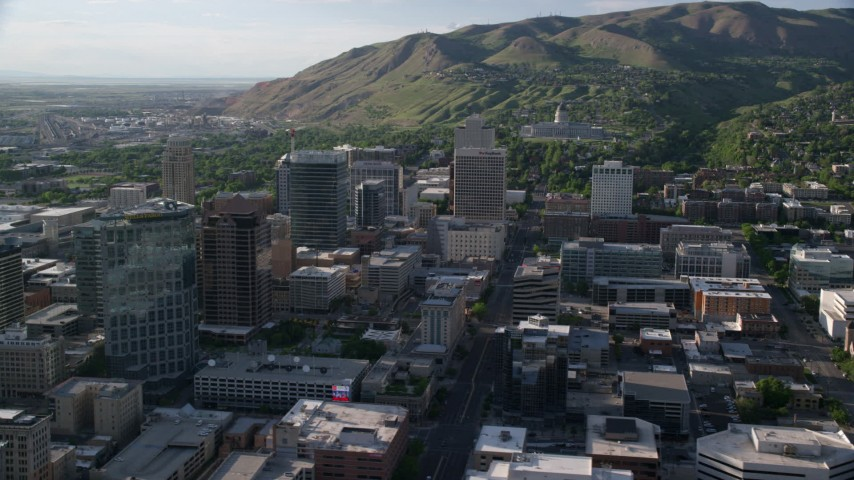 6K stock footage aerial video flyby city buildings, Utah State Capitol at end of State Street, Downtown Salt Lake City, Utah Aerial Stock Footage | AX129_146