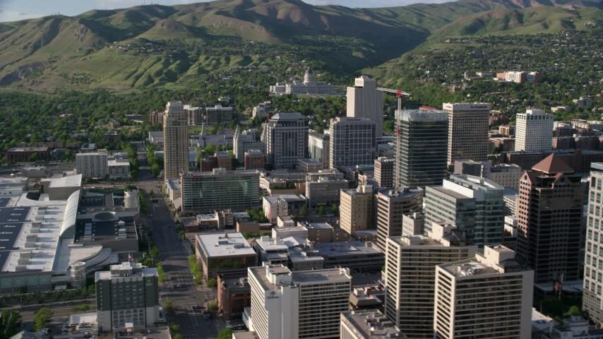 Fly by buildings, Utah State Capitol in background, Downtown Salt Lake City, Utah Aerial Stock Footage | AX129_147