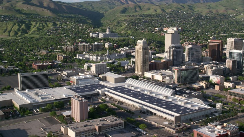 6K stock footage aerial video of city buildings, convention center, Utah State Capitol in background, Downtown Salt Lake City, Utah Aerial Stock Footage | AX129_148