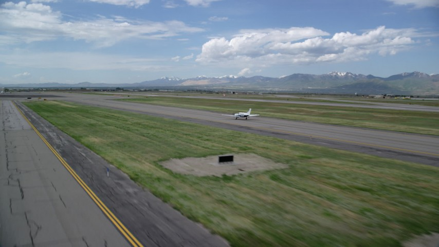 6K stock footage aerial video of tracking an airplane taking off, Salt Lake City International Airport, Utah Aerial Stock Footage | AX130_001