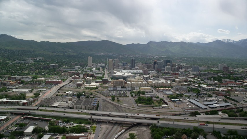 6K stock footage aerial video of flying over Interstate 15 with a view of Downtown Salt Lake City, Utah Aerial Stock Footage | AX130_004