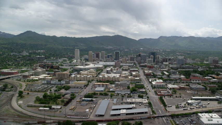 6K stock footage aerial video of flying by the downtown area, Wasatch Range in the background, Downtown Salt Lake City, Utah Aerial Stock Footage | AX130_005