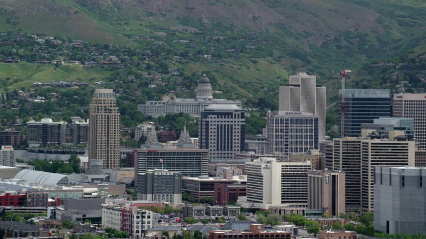 Flying by Downtown, Utah State Capitol, Capitol Hill, Salt Lake City, Utah Aerial Stock Footage | AX130_009