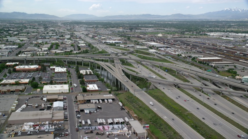 6K stock footage aerial video of approaching I-80 and I-15 interchange, Salt Lake City, Utah Aerial Stock Footage | AX130_010