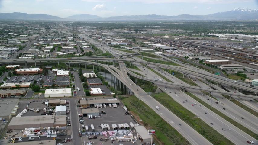 Approaching Interstate 80 and Interstate 15 Interchange, Salt Lake City, Utah Aerial Stock Footage | AX130_010
