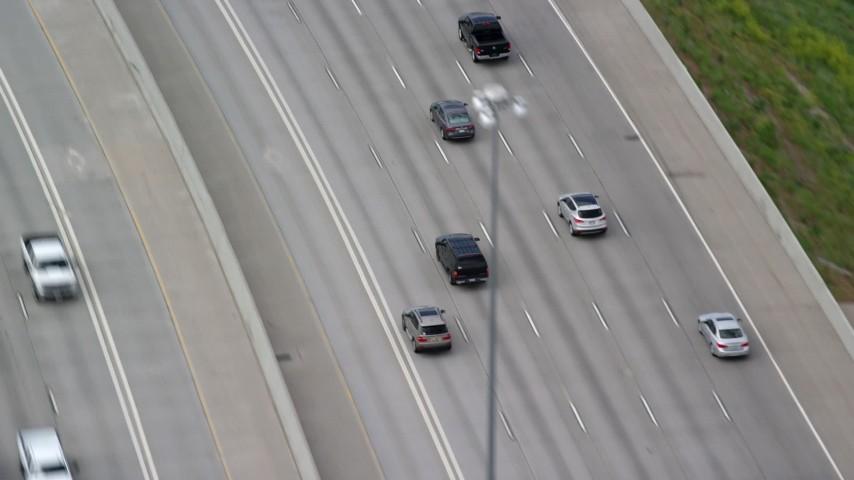 6K stock footage video of tracking black SUV on Interstate 15, Salt Lake City, Utah Aerial Stock Footage | AX130_013