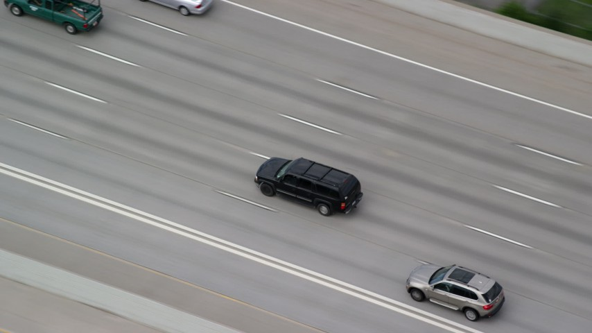 6K stock footage aerial video track a black SUV on I-15, light traffic, Salt Lake City, Utah Aerial Stock Footage AX130_014 | Axiom Images