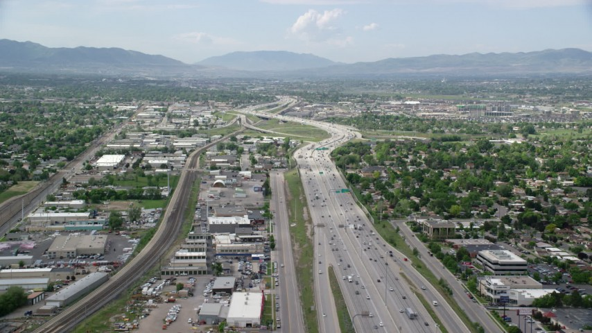 6K stock footage aerial video of flying over I-15 and passing homes, Salt Lake City, Utah Aerial Stock Footage | AX130_018