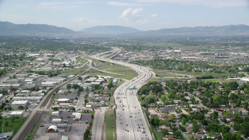 Flying over Interstate 15, light traffic, Salt Lake City, Utah Aerial Stock Footage | AX130_019