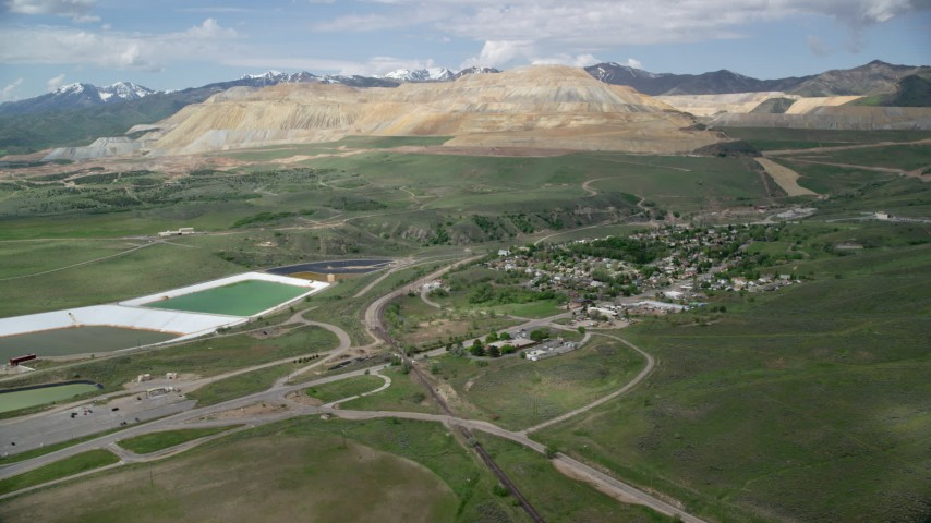 Approaching Bingham Canyon Mine (Kennecott Copper Mine), Copperton, Utah Aerial Stock Footage | AX130_029