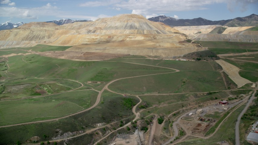 6K stock footage aerial video of flying toward Bingham Canyon Mine (Kennecott Copper Mine), Copperton, Utah Aerial Stock Footage | AX130_032