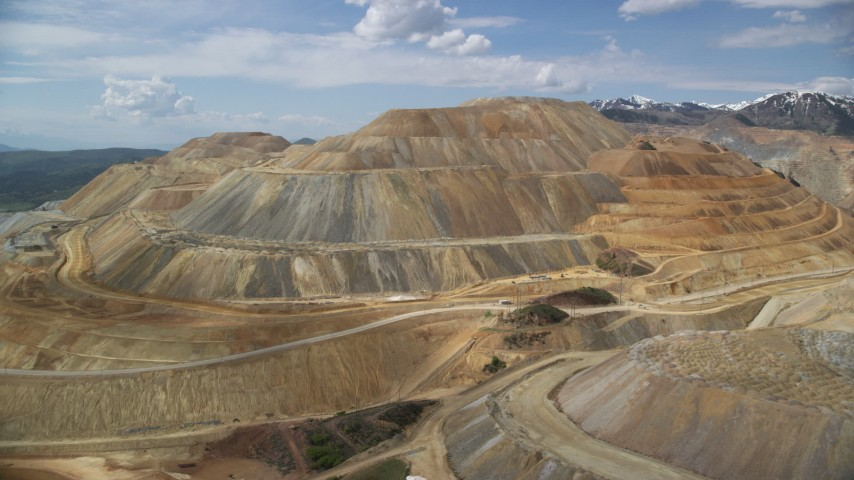 6K stock footage aerial video of passing by Bingham Canyon Mine (Kennecott Copper Mine), Utah Aerial Stock Footage | AX130_034