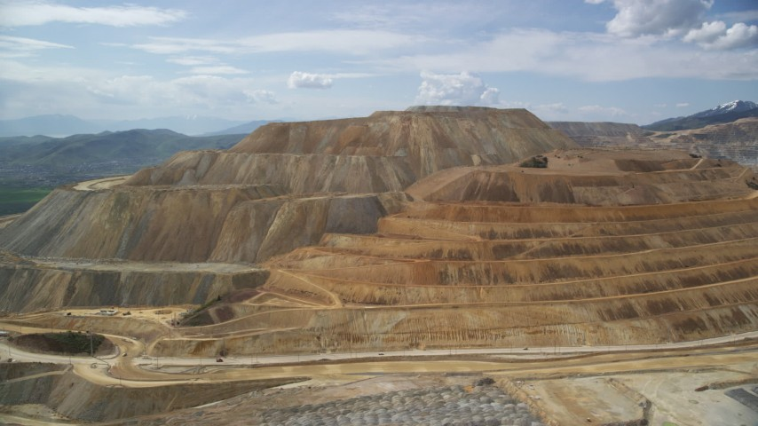 Flying by Bingham Canyon Mine (Kennecott Copper Mine), Utah Aerial Stock Footage | AX130_036
