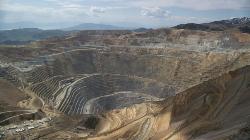6K stock footage aerial video circle the Bingham Canyon Mine (Kennecott Copper Mine), Utah Aerial Stock Footage | AX130_040